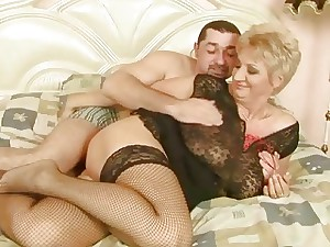 Grandma in fishnet tights gets banged