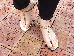Sexy all-natural feet in gorgeous gold sandals