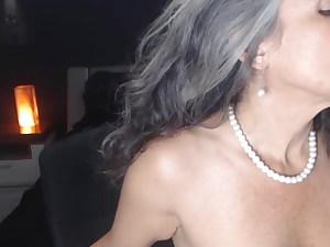 My naked busty granny gives a blowjob