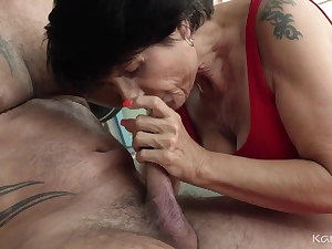 Sexy brunette grandma fucks young man in the gym